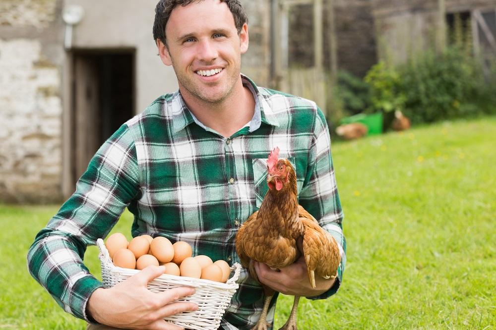 Boer met kip - HAS Blog - HAS Hogeschool